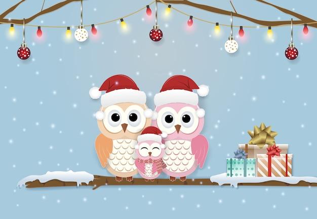 フクロウの家族新年のグリーティングカード