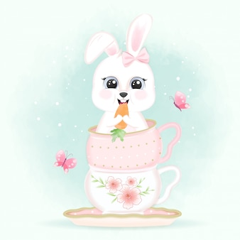 Кролик ест морковку в чашке кофе и бабочки