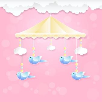 鳥のおもちゃと雲のピンクの赤ちゃんの携帯