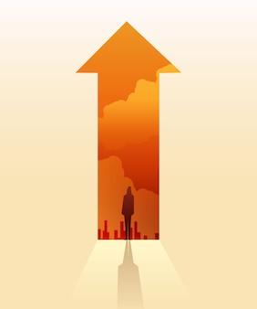 矢印に立っている実業家のシルエットは、目標またはターゲットへのパスを行く