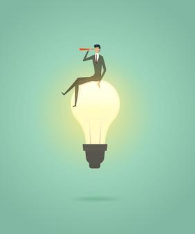 電球の創造的な概念ソリューションの上に座る実業家と望遠鏡でビジョンを見る