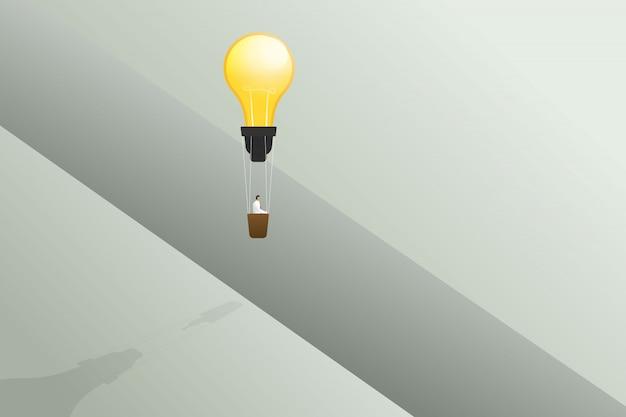 電球バルーンで飛んで実業家クロスギャップとビジネスソリューション、創造的なアイデアコンセプトのエッジ