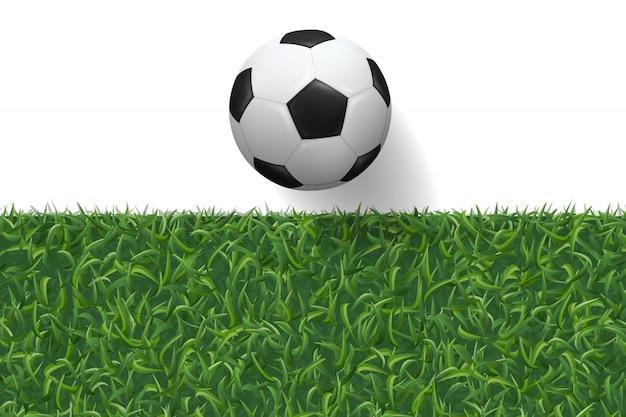 Текстура футбола футбола и зеленой травы для предпосылки.