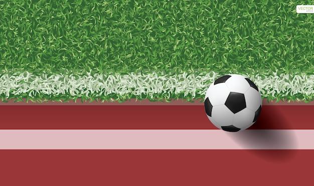緑色の芝生にサッカーのサッカーボール。