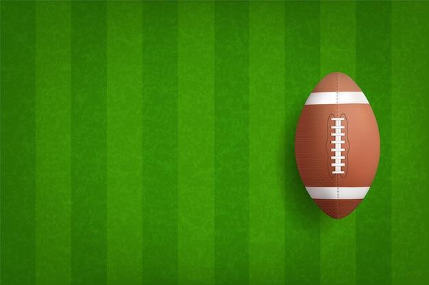 緑の芝生のアメリカンフットボールボール。