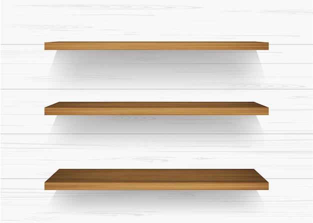 白い壁に木製の棚。