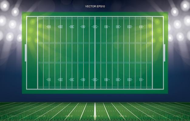 緑色の芝生のフィールドのパースペクティブラインパターンとフットボールフィールドスタジアムの背景。