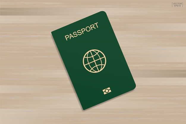 木製のパターンとテクスチャの背景に緑色のパスポート。