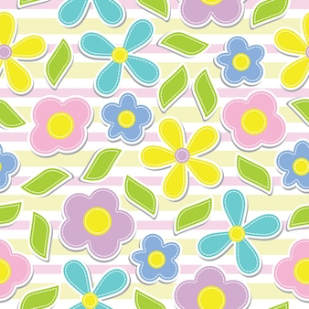 ピンクのストライプの背景に黄色、シアン、ピンク、紫色の花のシームレスなパターン