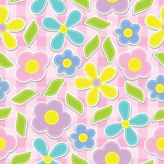 ピンクボックスの背景に黄色、シアン、ピンク、紫色の花のシームレスなパターン