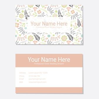 ピンクの花の背景と花の名刺テンプレート