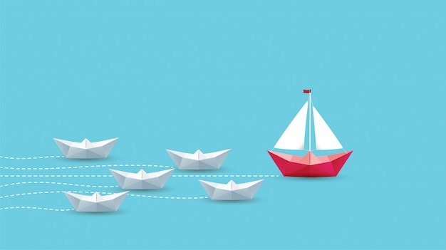 リーダーシップの概念、折り紙の赤い紙の船。