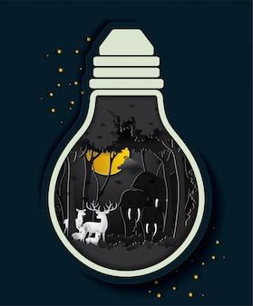 電球の夜の森の象と鹿。