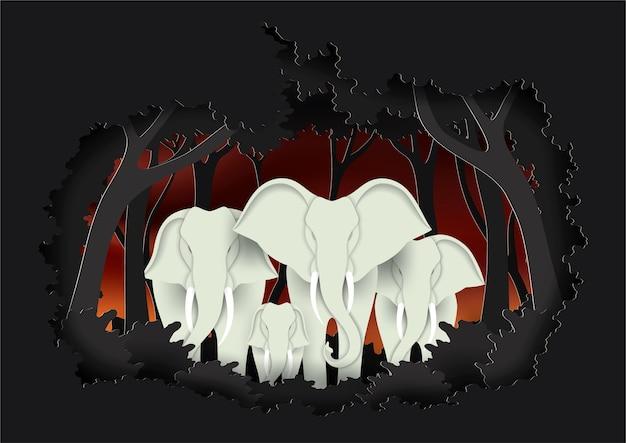 森の紙アートスタイルで象の家族。