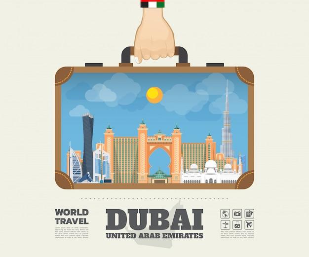 ドバイのランドマーク世界旅行と旅のインフォグラフィックバッグを運ぶ手。