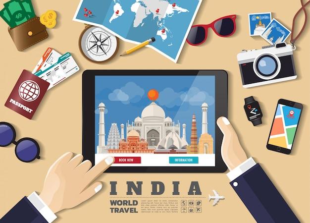 スマートタブレット予約旅行先を持っている手。インドの有名な場所。旅行オブジェクト、アクセサリー、観光のアイコンのセットを持つフラットスタイルのベクトル概念バナー。
