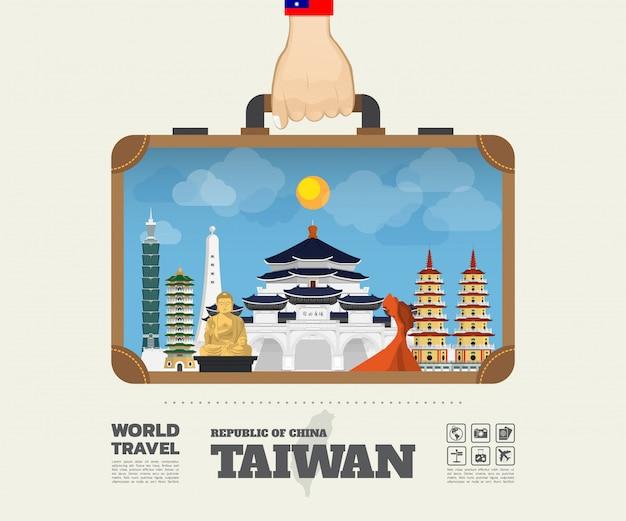 台湾ランドマークの世界旅行と旅のインフォグラフィックバッグを運ぶ手。