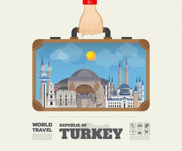 トルコのランドマークの世界旅行と旅インフォグラフィックバッグを運ぶ手。