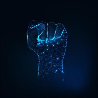 女性の拳のシルエット、輝く星の上げられた手