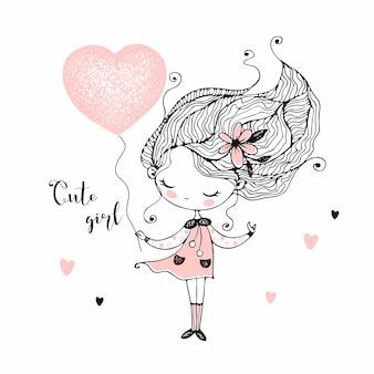 ハートの形の風船を持つかわいい女の子。