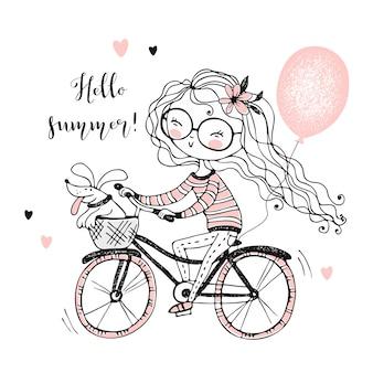 ペットの犬を持つ少女は、風船で自転車に乗ります。