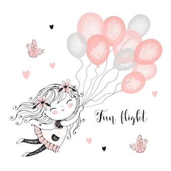 かわいい女の子が風船を飛んでいます。