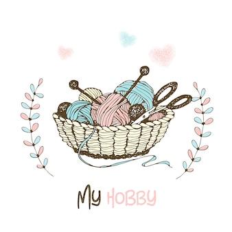 編み物、糸のかせ、羊毛、針の入ったバスケット。