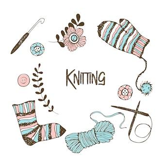 編み物をテーマにした要素のセット。糸、編み針、ミトン、靴下。