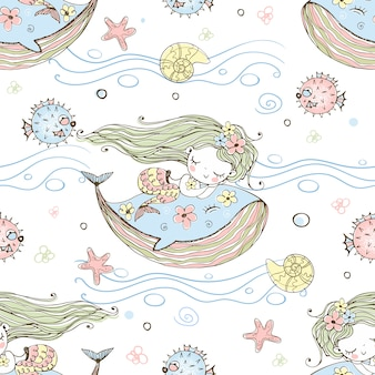 Милая маленькая русалка спит на кита.