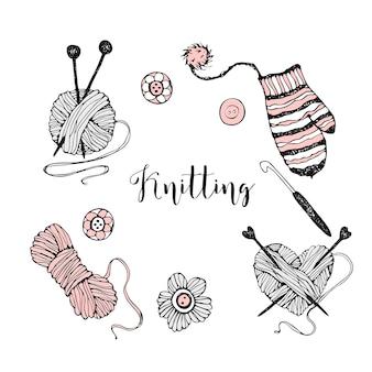 編み物をテーマにした要素のセット。糸、編み針、ミトン。
