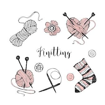 編み物をテーマにした要素のセット。糸、針、靴下。