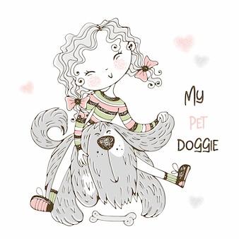 彼女の毛むくじゃらの友達犬と遊ぶかわいい女の子。