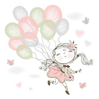 Маленькая милая девушка летит на воздушных шарах.