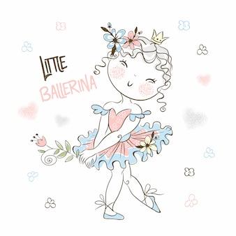 Милая маленькая балерина в пачке позирует красиво.