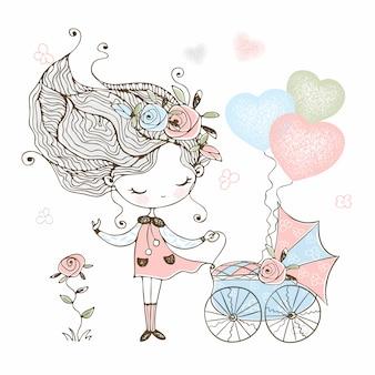 Милая маленькая девочка с игрушкой коляска с ребенком.