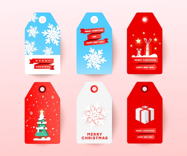 編集可能な休日の装飾が白で隔離入りクリスマスセールタグ。雪玉、クリスマスツリー、サプライズギフト、割引テキストでカット紙でラベルを付けます。