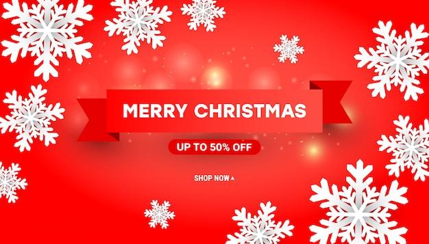紙でメリークリスマスセールのバナーは白い雪片、赤の赤いリボンをカット