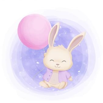 風船で遊ぶ小さなウサギ
