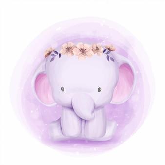 花の冠を持つ象の赤ちゃん