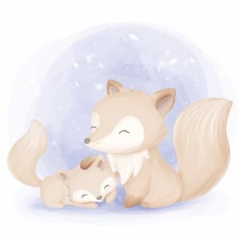 冬の季節のかわいい動物キツネの母親と赤ちゃん