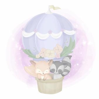気球のキツネとアライグマ