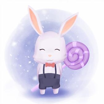 Кролик мальчик держит конфету на спине