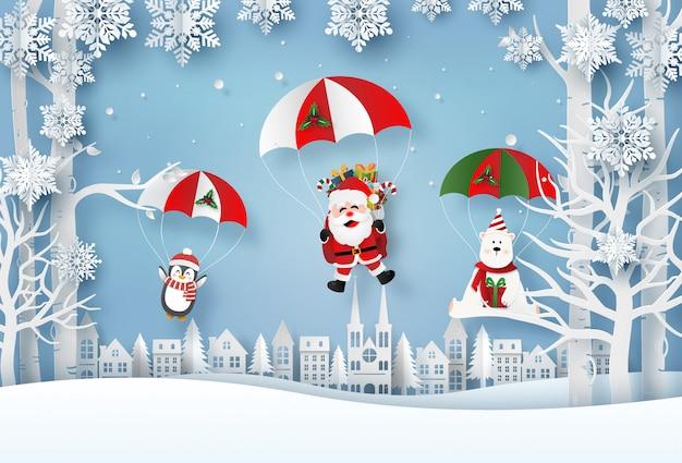 サンタクロースとクリスマスキャラクターが村でパラシュートジャンプをし、