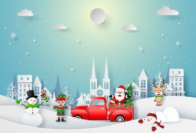 サンタクロースとクリスマスキャラクターの折り紙ペーパーアートを町で祝う