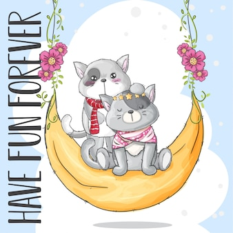 Милый котенок на лунной качели