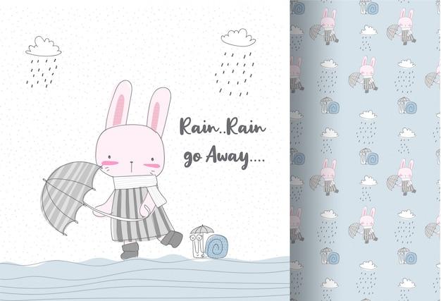 雨のシームレスなパターンでかわいいウサギ