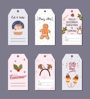 Рождественские поздравительные подарочные признаки установлены с зимними элементами и праздничной надписью.