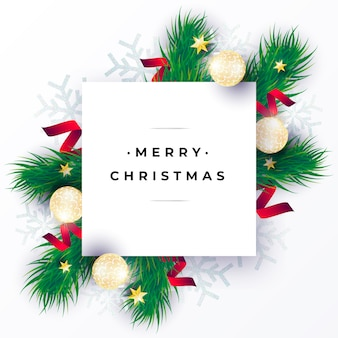 Реалистичная рождественская открытка с зелеными ветками