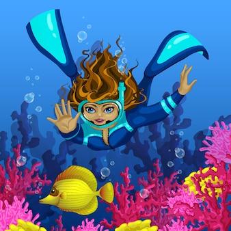 ガールダイバーは水の下で黄色の魚を捕まえます。