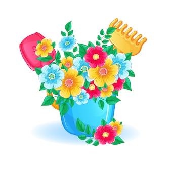 青い子供用おもちゃのバケツで美しい花の花束。